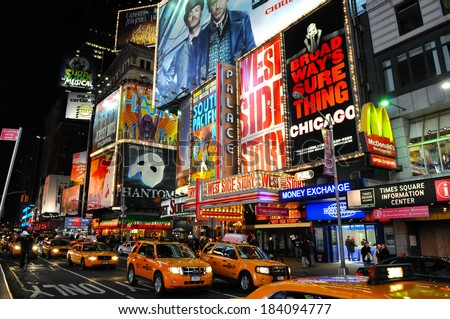 NEW YORK CITY - DECEMBER 7: Yellow taxi cabs and glowing electric signs abound at night in Times Square on December 7, 2009 in New York City, New York, USA. - stock photo
