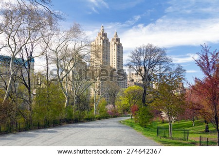 NEW YORK CITY - Empty trail winds through the colorful spring trees in Central Park - stock photo