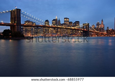 New York City evening skyline with Brooklyn Bridge - stock photo