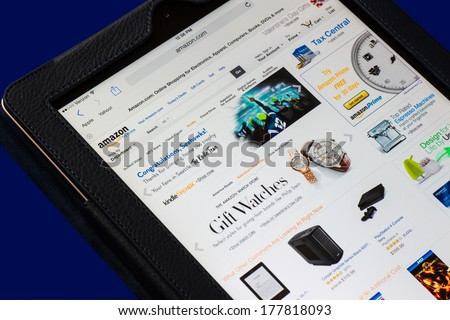 NEW YORK CITY - FEB 3, 2014:  Electronic tablet opened to Amazon homepage.  Amazon.com went online in 1995 and is now the largest online retailer in the world.  - stock photo