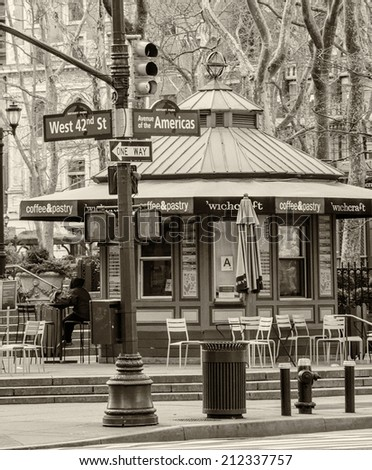 NEW YORK CITY - FEB 10, 2012: Entrance of Bryant Park on the Avenue of the Americas. Bryant Park is a 9,603 acre privately managed park in the center of Manhattan. - stock photo