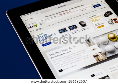 NEW YORK CITY - FEB 3, 2014: iPad opened to Ebay homepage.  Ebay, an online auction and shopping site, was founded in 1995.  - stock photo
