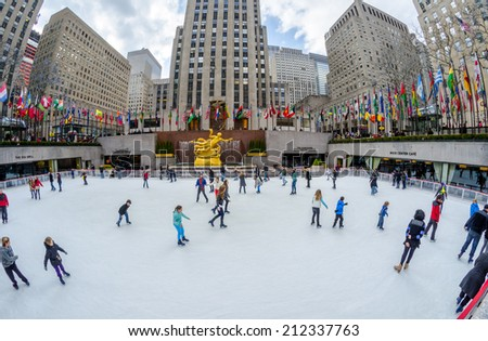 NEW YORK CITY - FEB 10: Locals and tourists watch and do ice skating at one of the most traditional tourist attractions of New York city, the Rockefeller Center Compound on February 10, 2012. - stock photo