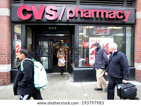 NEW YORK CITY - FEB. 18, 2014: Pedestrians walk past a CVS Pharmacy n New York City on Tuesday,  February 18, 2014. CVS is the retail division of CVS Caremark. - stock photo