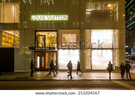 NEW YORK CITY - FEB 11: Shopping street at 5th Avenue in NYC with tourists on  February 11, 2015. It is considered among the most expensive and best shopping streets in the world. - stock photo