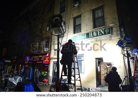 "NEW YORK CITY - FEBRUARY 4 2015: crews shooting an episode of the Fox series ""Gotham"" set up in Sunset Park, Brooklyn, using the popular local tavern Irish Haven, previously a site for ""The Departed"" - stock photo"