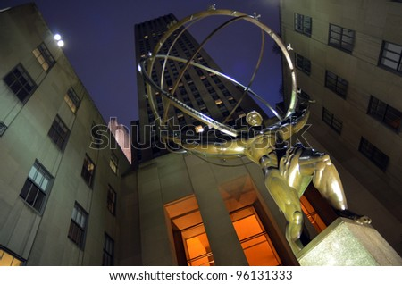 NEW YORK CITY - FEBRUARY 25: Fifth Avenue, as a symbol of wealthy New York, with Atlas statue and Rockefeller center at dusk, February 25, 2012 in Manhattan, New York City. - stock photo