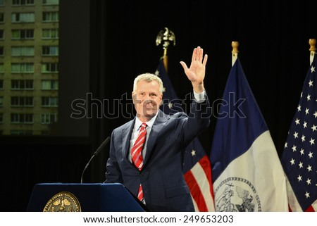 NEW YORK CITY - FEBRUARY 3 2015: Mayor Bill De Blasio gave his second annual state of the city at Mason Hall in Baruch College. Mayor De Blasio waves to applause after being introduced - stock photo