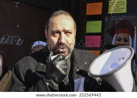 NEW YORK CITY - FEBRUARY 13 2015: Members of the Muslim community staged a vigil to call for justice in the killing of three Muslim Chapel Hill students. Minister addresses rally, - stock photo