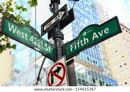 New York City Fifth Avenue and West 42nd street sign post. - stock photo
