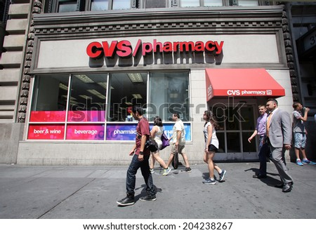 NEW YORK CITY - FRIDAY, JUNE 20, 2014: Shoppers walk past a CVS drug store in New York City on Wednesday, July 2, 2014.  CVS is the retail division of CVS Caremark - stock photo