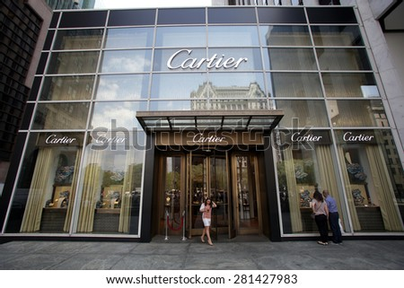 NEW YORK CITY - FRIDAY, MAY 8, 2015: Pedestrians walk past a Cartier jewelry store in New York City. Societe Cartier designs and sells jewellery and watches. Founded in Paris, France    - stock photo