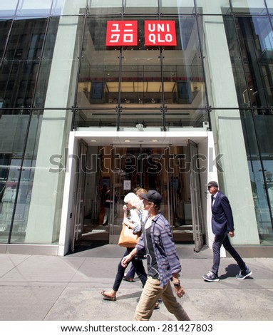 NEW YORK CITY - FRIDAY, MAY 8, 2015: Pedestrians walk past an Uniqlo clothing store in Manhattan. Uniqlo Co., Ltd. is a Japanese retailer and subsidiary of Fast Retailing Co., Ltd    - stock photo
