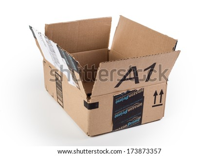 NEW YORK CITY - JAN. 21, 2014:  Opened Amazon Prime shipping package on white background. Amazon.com went online in 1995 and is now the largest online retailer in the world. - stock photo