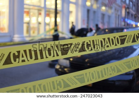NEW YORK CITY - JANUARY 25 2015: a shooting at the Home Depot store in Chelsea left two employees dead in what is being called a murder-suicide. Crime scene tape set out in front of store - stock photo