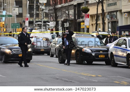 NEW YORK CITY - JANUARY 25 2015: a shooting at the Home Depot store in Chelsea left two employees dead in what is being called a murder-suicide. Investigators arrive at scene on 23rd Street  - stock photo