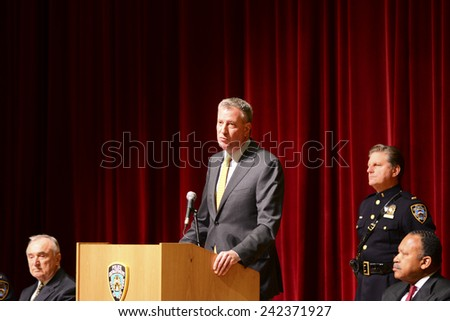NEW YORK CITY - JANUARY 7 2015: Mayor Bill De Blasio presided over the swearing in of NYPD academy graduates with a moment of silence for victims of the terror attack against Charlie Hebdo in Paris - stock photo