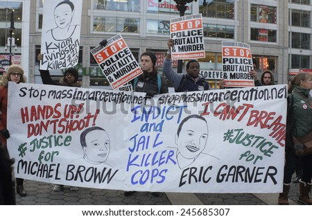 NEW YORK CITY - JANUARY 19 2015: several hundred activists gathered at Union Square Park prior to starting the Four Mile March on Martin Luther King's birthday. Eric Garner, Michael Brown banner - stock photo