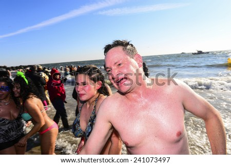 NEW YORK CITY - JANUARY 1 2014: several hundred people took part in the 9th annual Polar Bear Plunge in Coney Island, Brooklyn, to raise funds for Camp Sunshine - stock photo