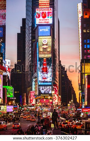 NEW YORK CITY - JANUARY 4: Times Square is a busy tourist intersection of neon art and commerce and is an iconic street of New York City and America, January 4th, 2009 in Manhattan, New York City. - stock photo