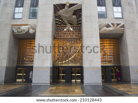 NEW YORK CITY - JANUARY 26: Wisdom, an art deco frieze by Lee Lawrie over the entrance of GE Building at Rockefeller plaza on January 26, 2014  - stock photo
