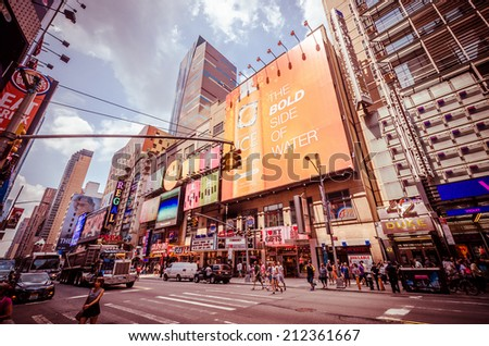 NEW YORK CITY - JUL 22: 42nd Street with traffic and commercials on July 22, 2014 in New York City. 42nd Street is a major crosstown street known for its theaters and landmark architectures. - stock photo