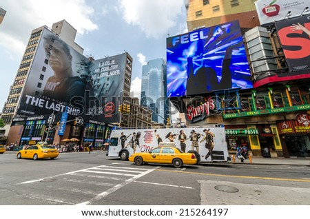 NEW YORK CITY - JUL 22: 8th Avenue with traffic and commercials on July 22, 2014 in New York City. Eighth Avenue is a north-south avenue of Manhattan, carrying northbound traffic. - stock photo