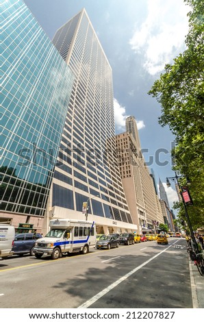 NEW YORK CITY - JUL 22: The Grace Building view from the street on July 22, 2014 in New York City. The building was designed principally by Gordon Bunshaft, and completed in 1974. - stock photo