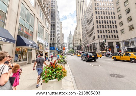 NEW YORK CITY - JUL 17: Traffic on 5th avenue on July 17, 2014 in New York. Fifth Avenue is a major thoroughfare in the center of the borough of Manhattan - stock photo
