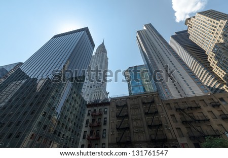 NEW YORK CITY - JULY 12: Facade of Chrysler Building on July 12, 2012. The Chrysler Building is an Art Deco style skyscraper in New York City, located on the east side of Manhattan. - stock photo
