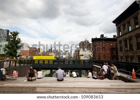 NEW YORK CITY - JULY 31: High Line Park in NYC as seen on July 31, 2012. In 2009 this former elevated freight railroad spur on NYC's west side opened as an aerial park garden and continues to expand. - stock photo