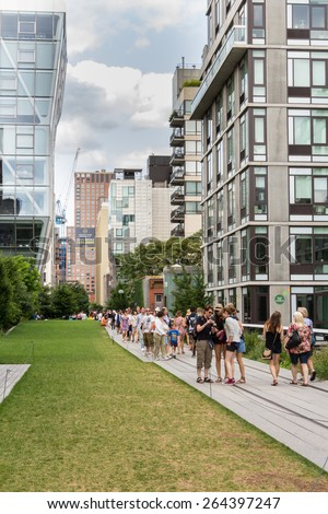 NEW YORK CITY - JULY 29,2014: People walking in High Line Park in New York. The High Line is a public park built on an old railway track elevated above the streets of Manhattan. - stock photo