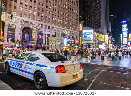 NEW YORK CITY-JULY 21: Police car in the Times Square on July 21,2012 in New York,Times Square is major commercial intersection in New york and one of the most visited tourist attractions in the world. - stock photo