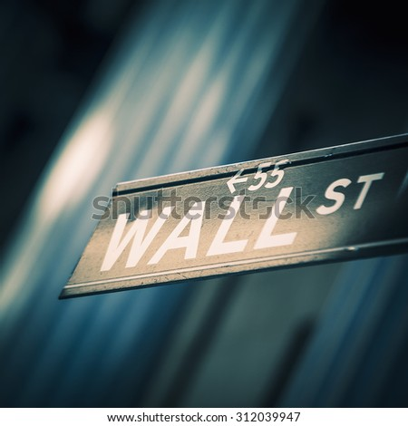 NEW YORK CITY - JULY 11: Street sign at the corner between Wall Street and Broadway, on July 11, 2015 in New York City.  - stock photo