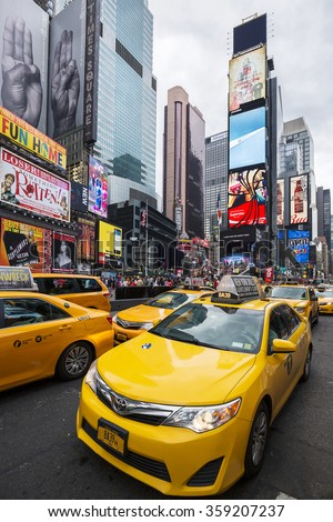 NEW YORK CITY - JULY 8: Taxi on Times Square, an iconic street of New York City and America, July 8, 2015 in Manhattan, New York City. Special photographic processing - stock photo