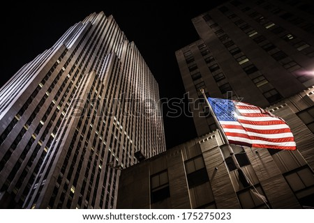 NEW YORK CITY - JULY 04: The flag of the USA at night at the Rockefeller center on July 04, 2013 in New York, NY.  - stock photo
