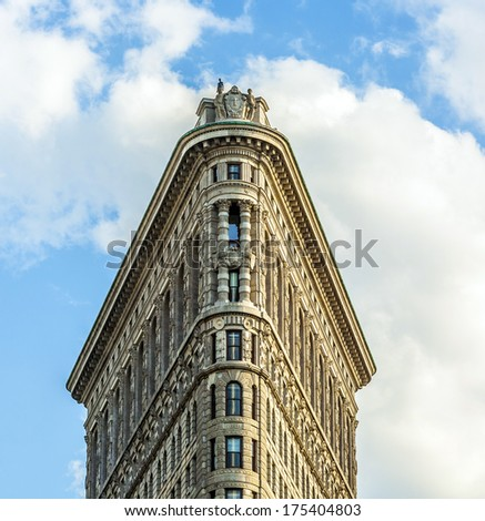 NEW YORK CITY - JULY 12: The Flatiron building in Manhattan July 12, 2010 in New York, NY. Considered a groundbreaking architectural feat, it was completed in 1902. - stock photo