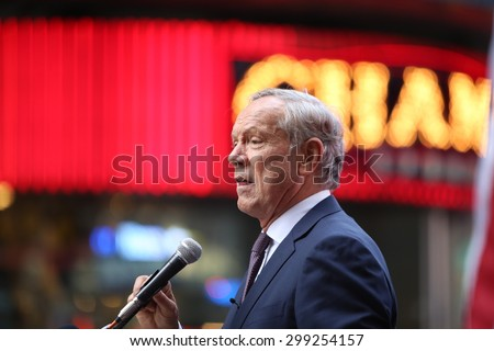 NEW YORK CITY - JULY 22 2015: thousands rallied in Times Square to oppose the President's proposed nuclear deal with Iran. Former NY governor George Pataki speaks out - stock photo