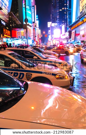 NEW YORK CITY - JULY 26:  Times Square, lined with NYPD police cars on July 26, 2011 in Manhattan, New York City.  New York Police Department has a station in Times Square. - stock photo