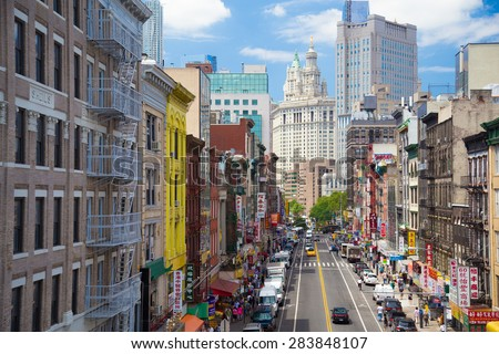 NEW YORK CITY - JULY 26, 2013:  View of Chinatown down East Broadway in lower Manhattan looking towards City Hall. - stock photo
