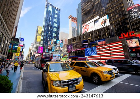 NEW YORK CITY - JULY 11: Yellow taxis on 7th Avenue in Times Square with crowds of people and lots of advertising on July 11, 2012 in New York, NY, US. - stock photo