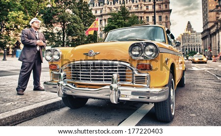 NEW YORK CITY - JUN 11:  A vintage antique yellow taxi cab on city streets, June 11, 2013 in New York City. Many old taxis are used as complimentary shuttle service by the city hotels. - stock photo