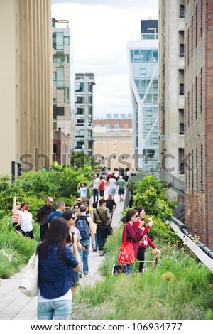 NEW YORK CITY - JUN 24: High Line Park in NYC on June 24th, 2012. The High Line is a public park built on an historic freight rail line elevated above the streets on Manhattans West Side. - stock photo