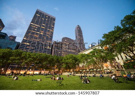 NEW YORK CITY - JUN 1: People enjoying a nice evening in Bryant Park on June 1, 2013 in New York City, NY. Bryant Park is a 9,603 acre privately managed park in the center of Manhattan - stock photo