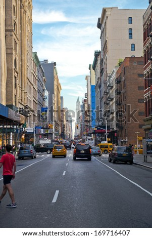 NEW YORK CITY - June 2: Busy Broadway Street on June 6, 2013 in New York City. With a population of 8.2 million, New York City is the most populous city in the USA.  - stock photo