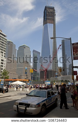 NEW YORK CITY - JUNE 3: Construction on the One World Trade Center (formerly the Freedom Tower) surpasses the 106 floor on June 3, 2012 in New York City, NY, USA - stock photo