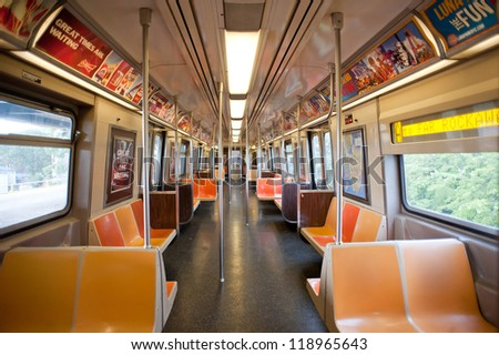 NEW YORK CITY - JUNE 26: Empty subway wagon on June 26, 2012 in NYC. The NYC Subway is one of the oldest and most extensive public transportation systems in the world, with 468 stations. - stock photo