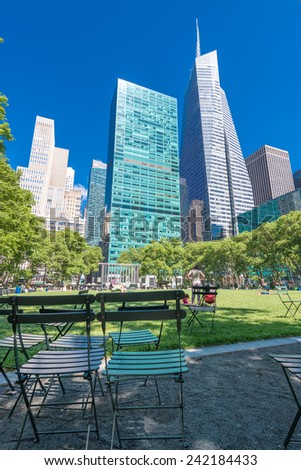 NEW YORK CITY - JUNE 11, 2013: Locals and tourists relax in Bryant Park. New York attracts more than 50 million people annually. - stock photo