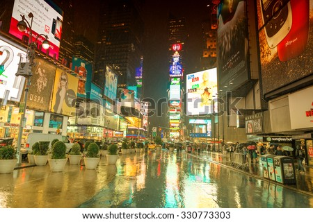 NEW YORK CITY - JUNE 13, 2013: Rainy night with tourists in Times Square. Times Square is a major commercial intersection and neighborhood in Midtown Manhattan. - stock photo