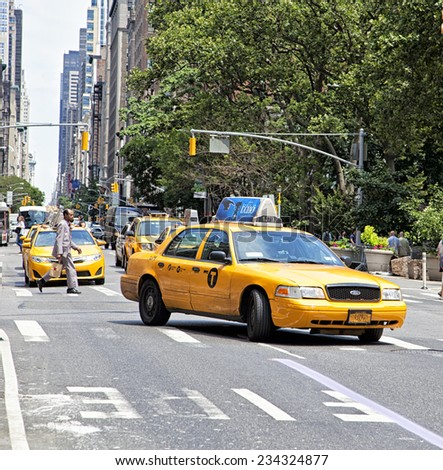 New York City - June 28th, 2014:Yellow Taxi traveling down the street in New York City, NY on June 28th, 2014.  - stock photo